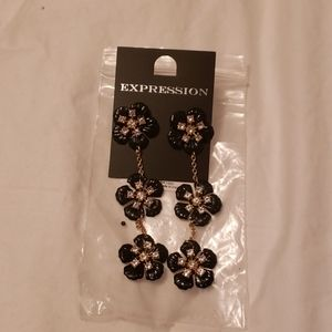 Black and gold coloured flower earrings